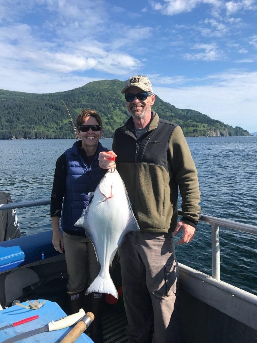 Holding a Halibut at Whales Pass Kodiak Island Alaska world class fishing
