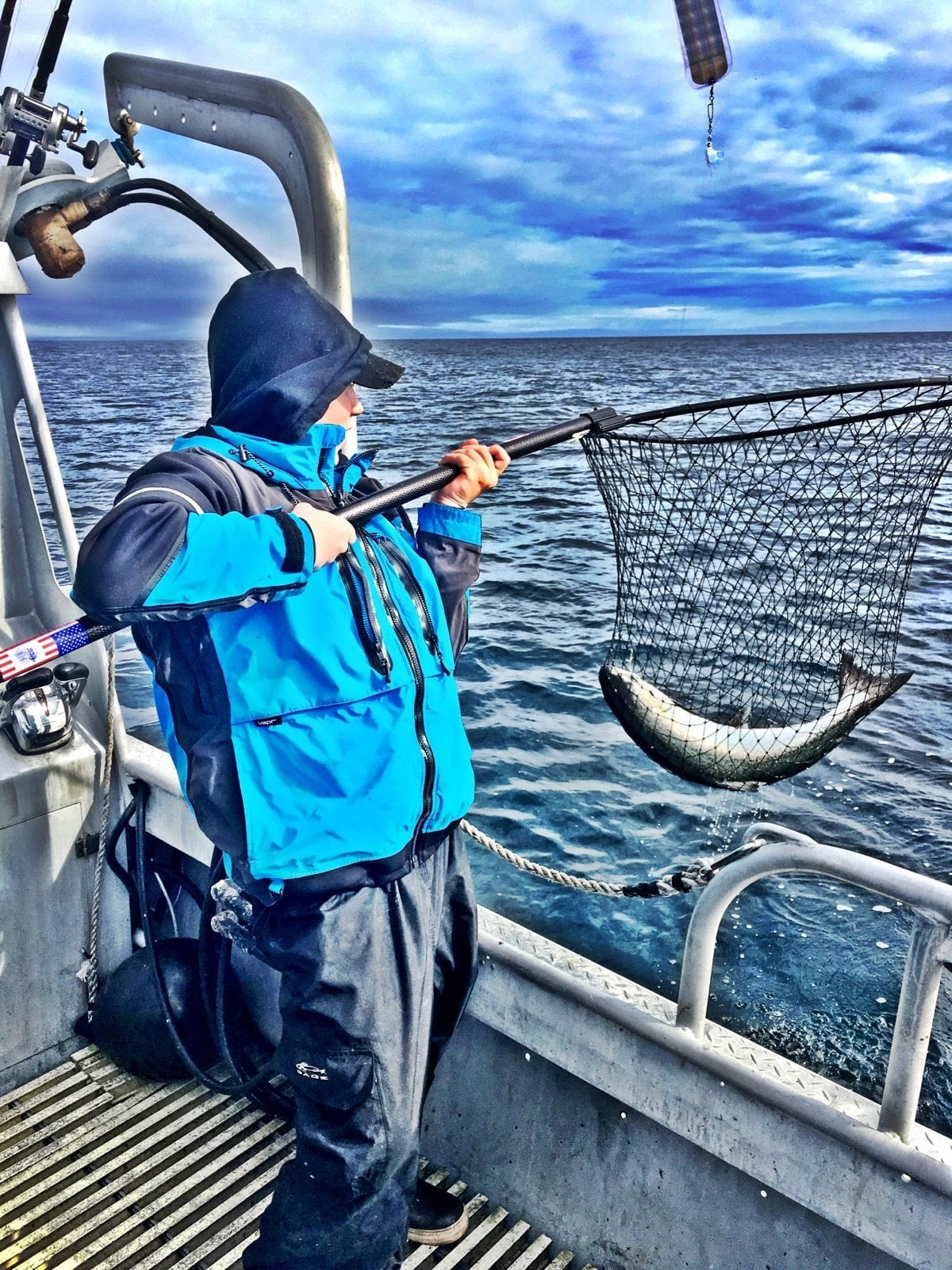 Sky Ardinger neting a King Salmon on Fish N' Chips Charters Kodiak's best Salmon Charter!