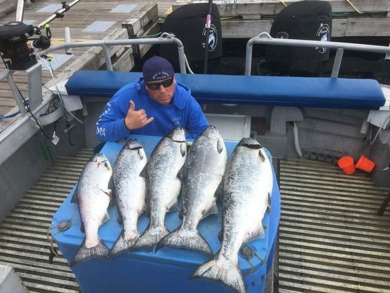 Capt. Dave with King Salmon sporting Fish N' Chips Charters Gear -Kodiak Island Charter Fishing in Alaska