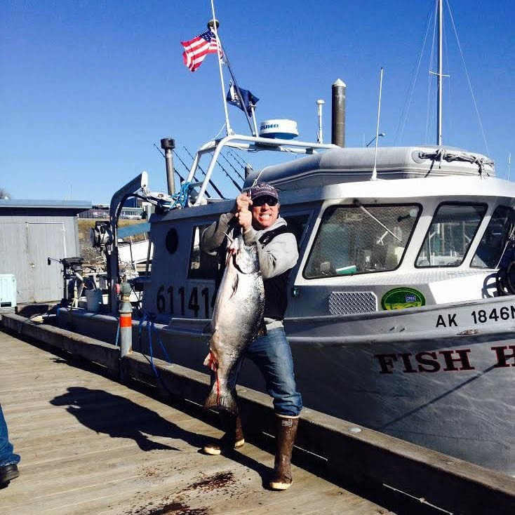 Capt. Dave holding Huge King Salmon on Fish N' Chips Charters in Kodiak Alaska