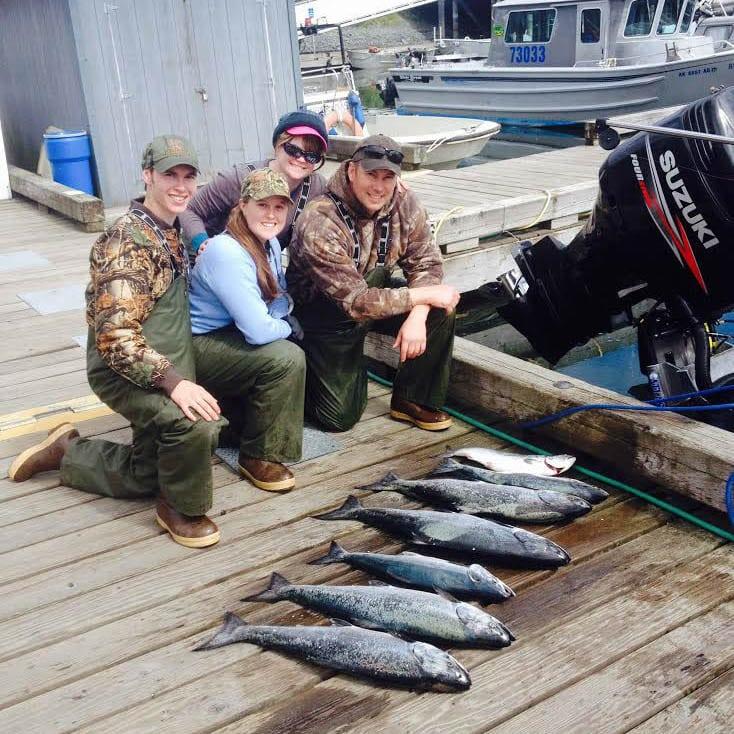 Family catches their King Salmon on Kodiak Island Alaska Fishing Charters Fish N' Chips Charters