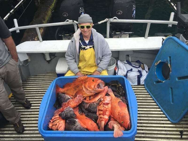 Conrad is Happy with a days catch on Fish N' Chips Charters Kodiak's Worldclass Fishing Charter